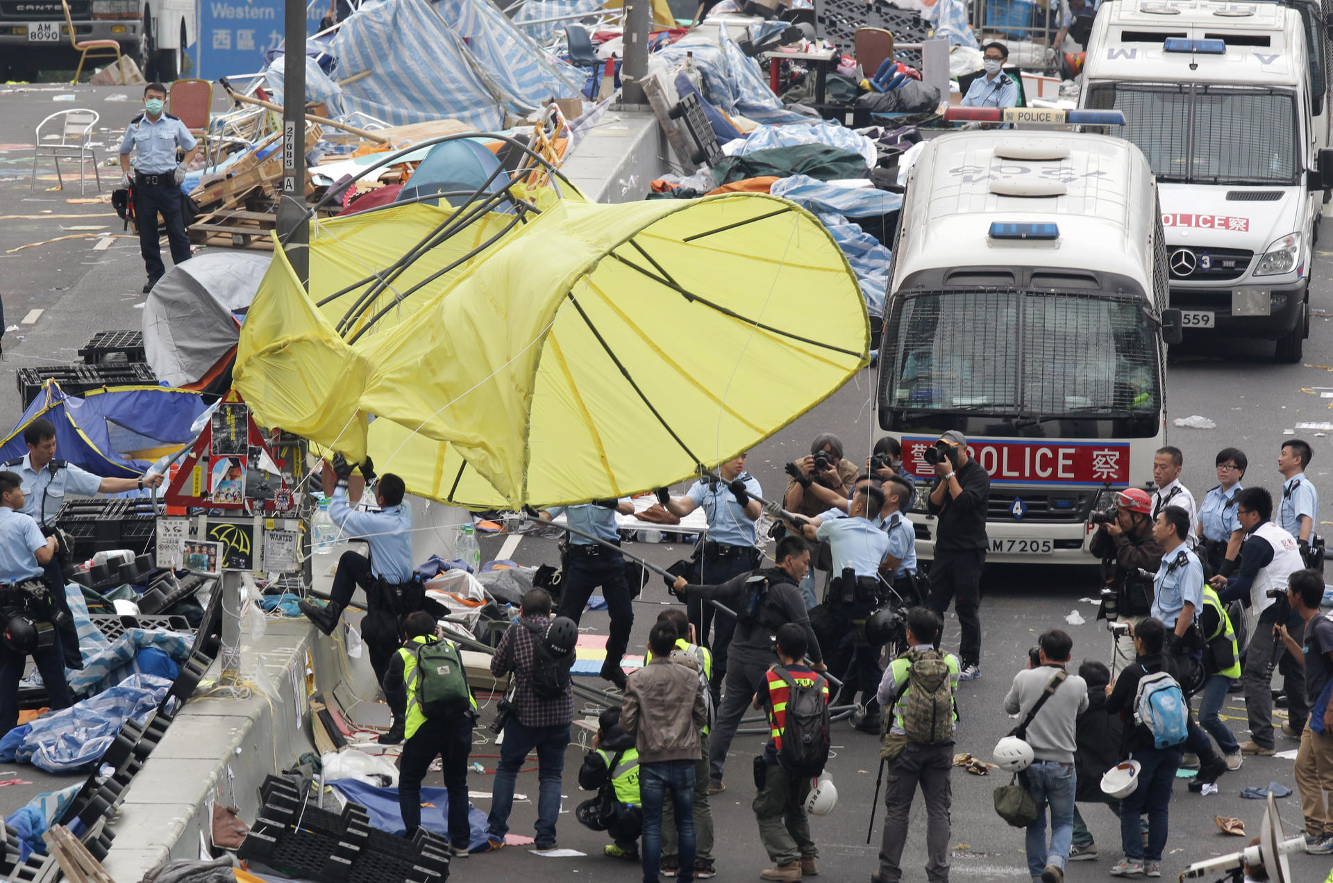 police and workers took down a giant umbrella that had become a symbol for protesters: metre giant umbrella