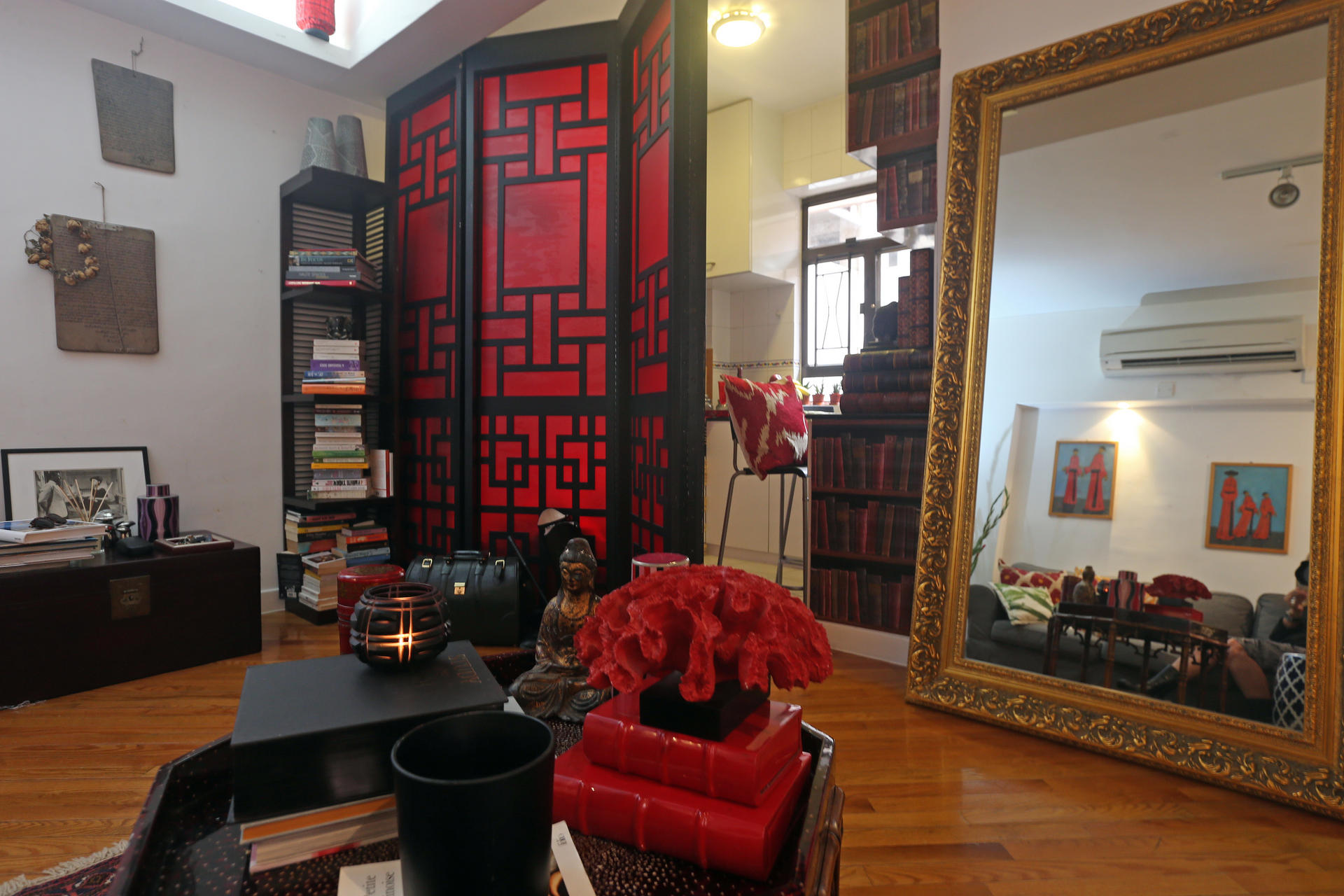Living And Kitchen Areas Are Delineated With Key Pieces That Create Distinct The Red Linen Andblack Lacquer Room Divider Cost HK2000 Was