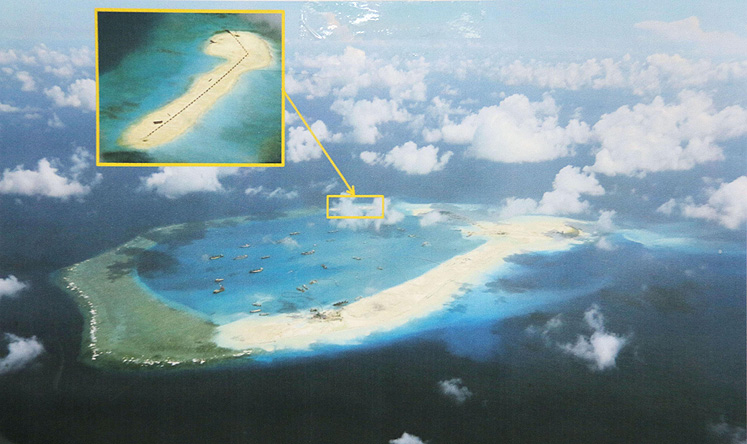 On visit to Beijing, Kerry urges easing of South China Sea ...