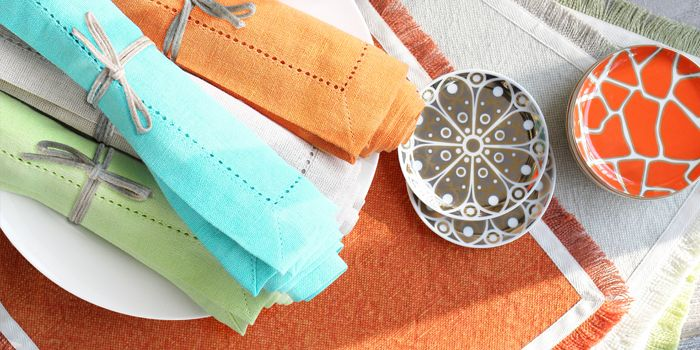 Replace paper napkins with traditional table linens, such as this range from Indigo Living.