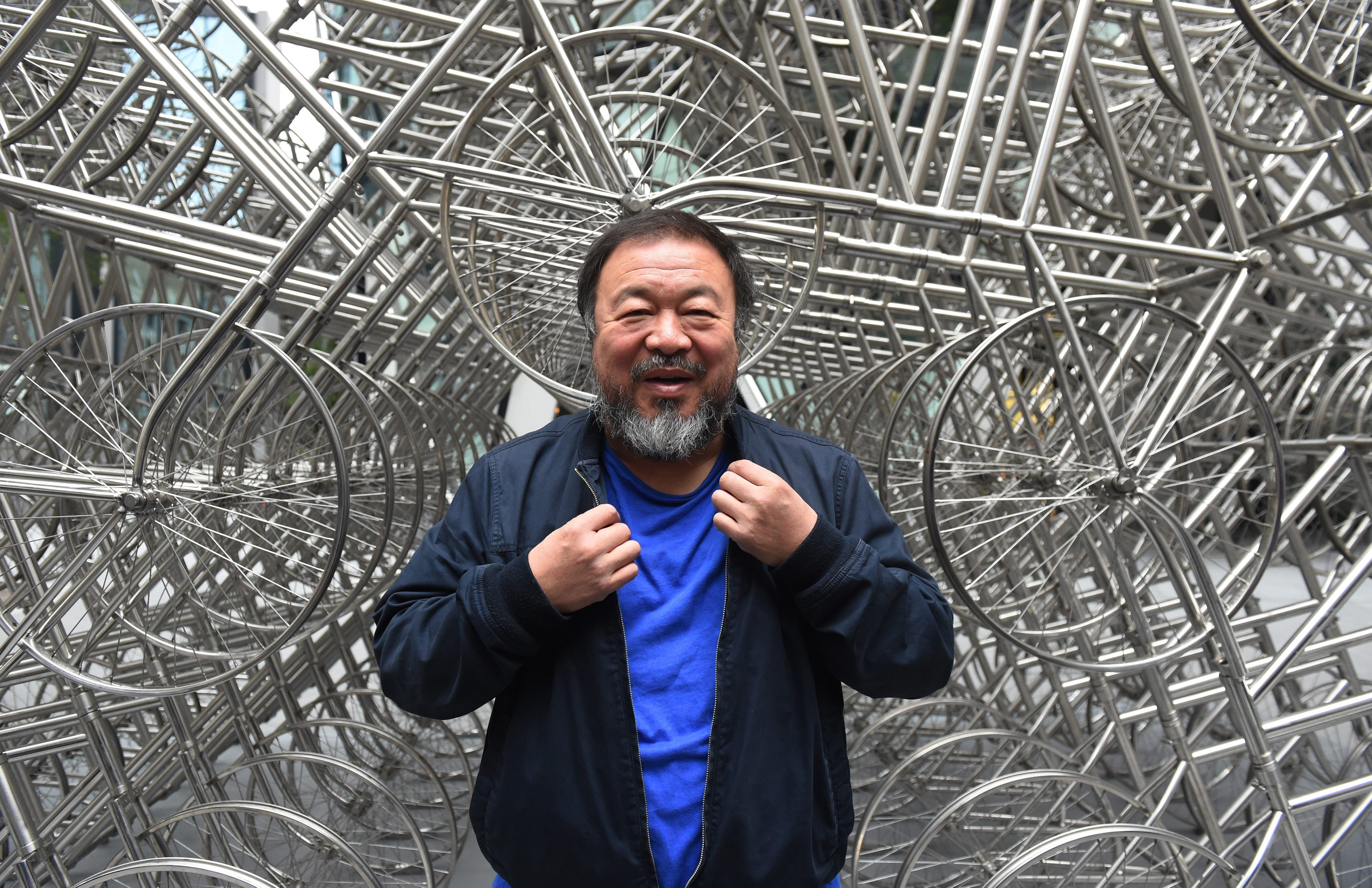 sandra model pissing Ai Weiwei at the unveiling of Forever, consists of 1,245 bicycle frames,  outside the Gherkin building in London. Photo: EPA