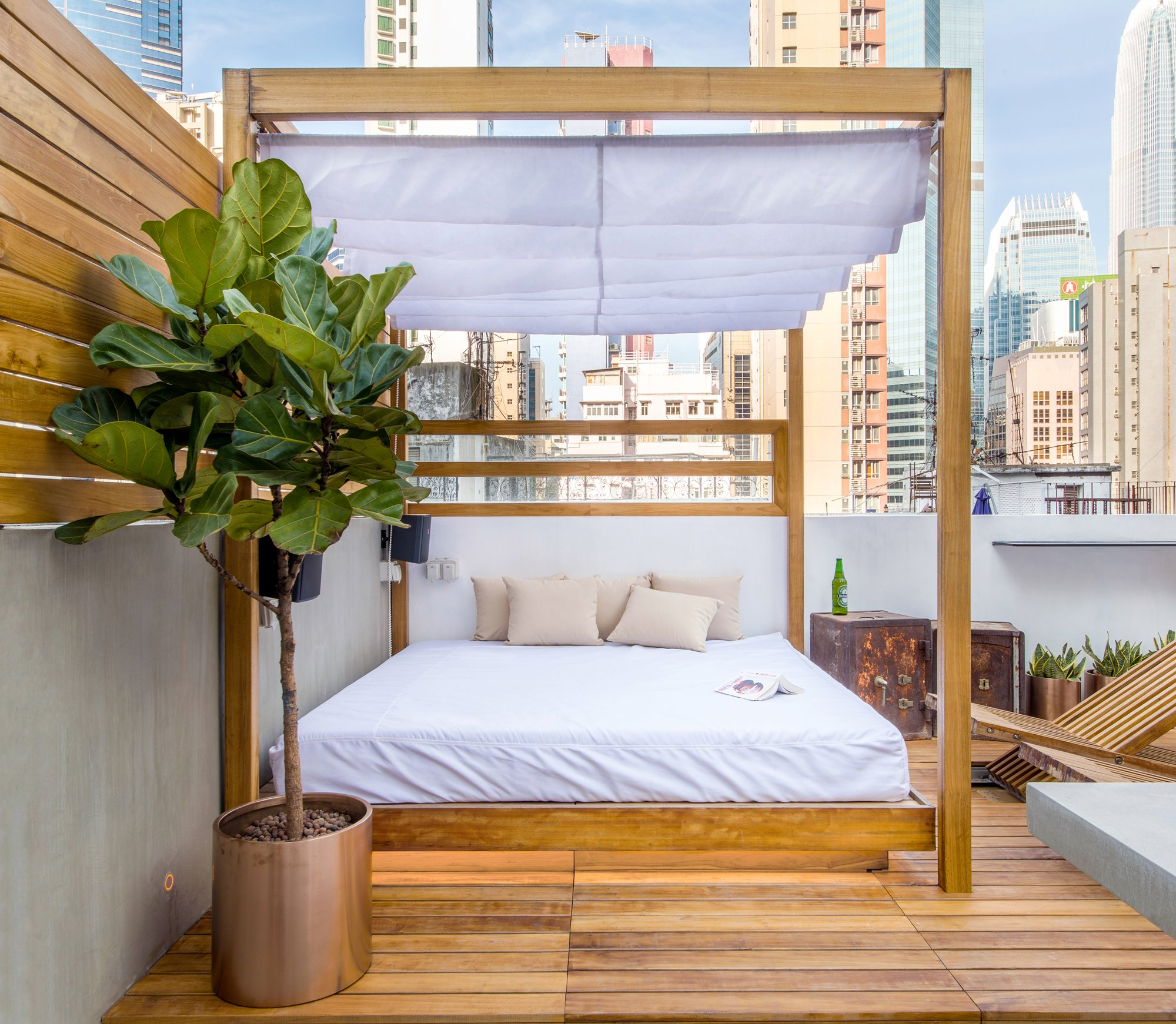 Rooftop The teak-framed bed is designed both for sunbathing and shade with a retractable cloth awning (HK$24000; Mark III Design and Contracting ... & How Hong Kong walk-up flat became a hi-tech rooftop retreat | Post ...