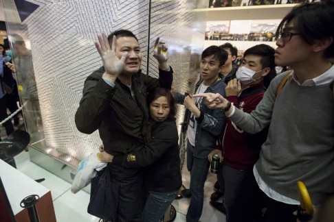 Protesters clash with a mainland traveller during a rally against parallel trading. Photo: Reuters