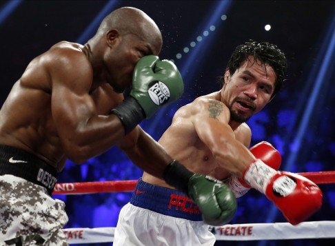 e443fc60e1ce Manny Pacquiao (right) defeats Timothy Bradley in a WBO welterweight title  match in Las