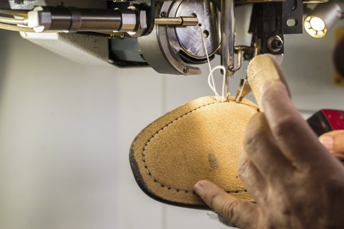 Christian Louboutin men's shoes being made in a Naples factory
