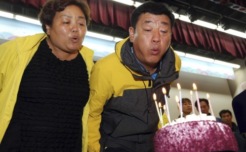 Parents blow candles off birthday cake for deceased daughter