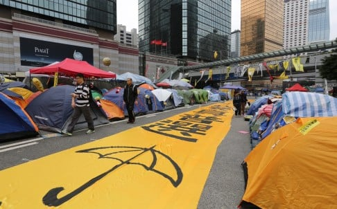 An image of a yellow umbrella is spread out on the road at the site of the Admiralty Occupy protest, on December 7. Photo: Sam Tsang