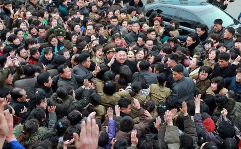 North Korean leader Kim Jong-un is surrounded by well-wishers during a visit to a textile mill in Pyongyang. Photo: AFP