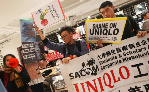 A protest in Uniqlo's store in Festival Walk, Kowloon Tong, after claims were made about the brand's suppliers. Photo: David Wong
