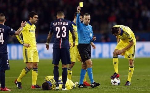 Referee Cuneyt Ckir finally tires of the treatment meted out to Eden Hazard and books Marco Verratti of Paris Saint-Germain during last week's Champions League tie. Photo: EPA