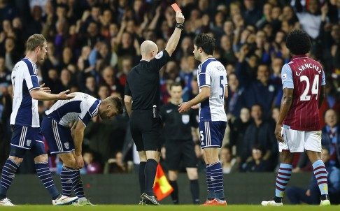 Referee Anthony Taylor sends off West Brom's Claudio Jacob. Colour psycghology suggests black shirts command discipline. Photo: Reuters