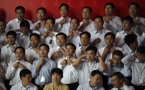 Trainees at a communist party school called China Executive Leadership Academy of Pudong in Shanghai prepare to pose for a group photo. Photo: Reuters