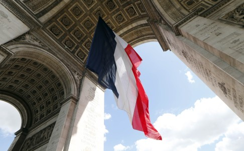 A French flag hangs under the Arc de Triomphe monument in Paris in preparation for Europe Day celebrations. Photo: AFP