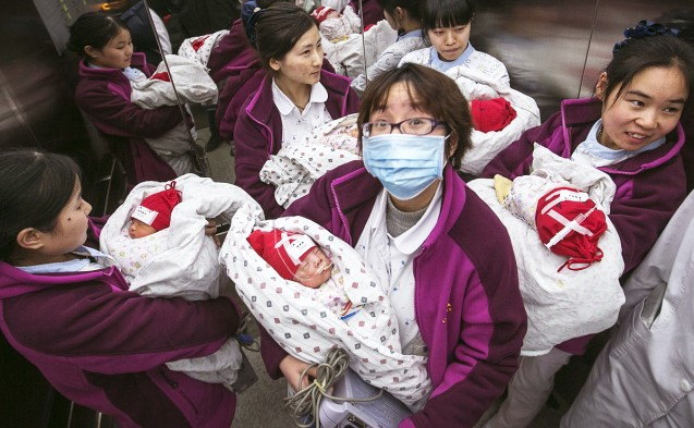 Critical move - Nurses carry newborn babies, suffering from critical diseases, in a lift as they transfer them to a new building at a hospital in the eastern city of Hangzhou in Zhejiang province. Local media said 38 children were moved to the new wing on Monday under police escort. This showed the sensitivity of the operation to transfer the children. Photo: Reuters