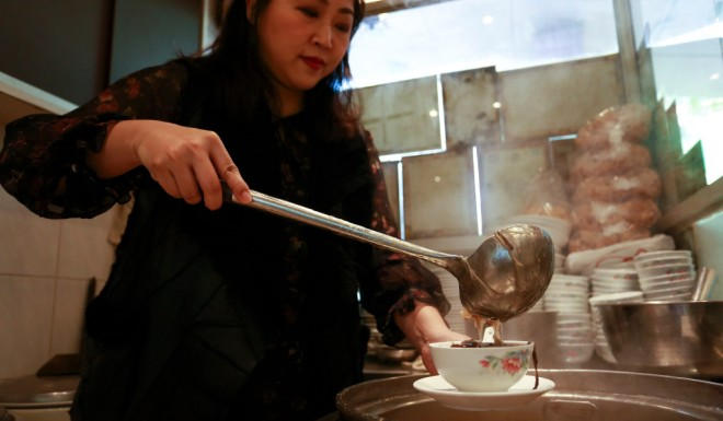 Gigi Ng prepares the dish at her family's business in Hong Kong's Central district.