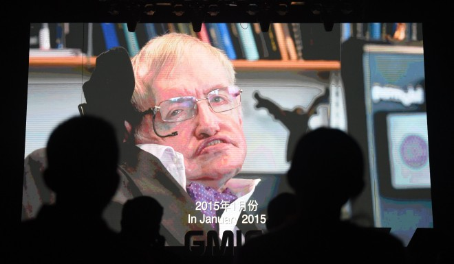 Participants listen to a recorded speech by Stephen Hawking on artificial intelligence as his image is seen on a screen at the Global Mobile Internet Conference in Beijing on April 27, 2017.