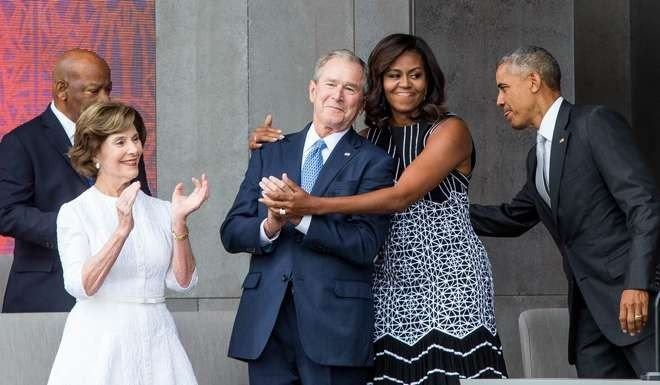 Michelle Obama gives George W. Bush a great big hug and the ...