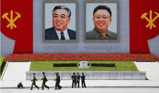 Why public calls for china to rein in north korea risk backfiring pictures of former north korean leaders kim il sung left and kim jong il in central pyongyang north korea photo reuters thecheapjerseys Choice Image